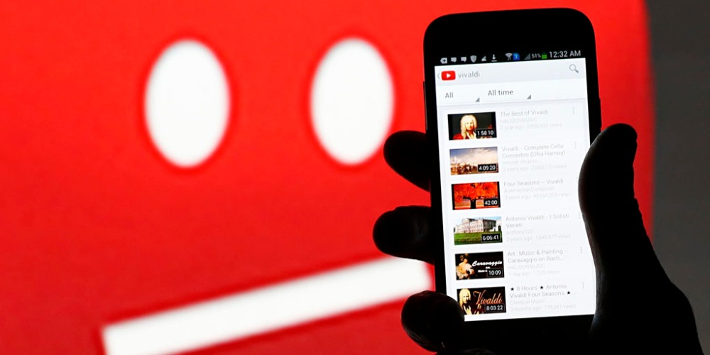 YouTube on a smartphone: the company is accused of playing Goliath to small indie music labels.