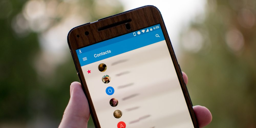 Google Contacts 1.5 update includes a complete redesign, labels, and duplicate contact removal