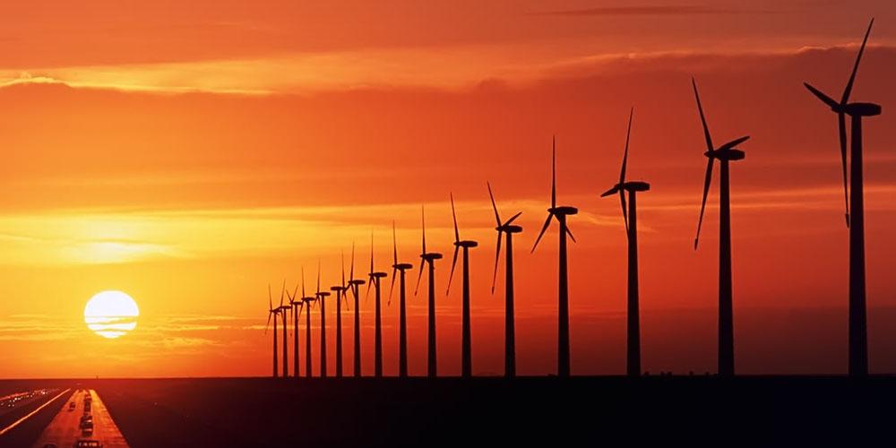 wind-turbine-farm-sunset