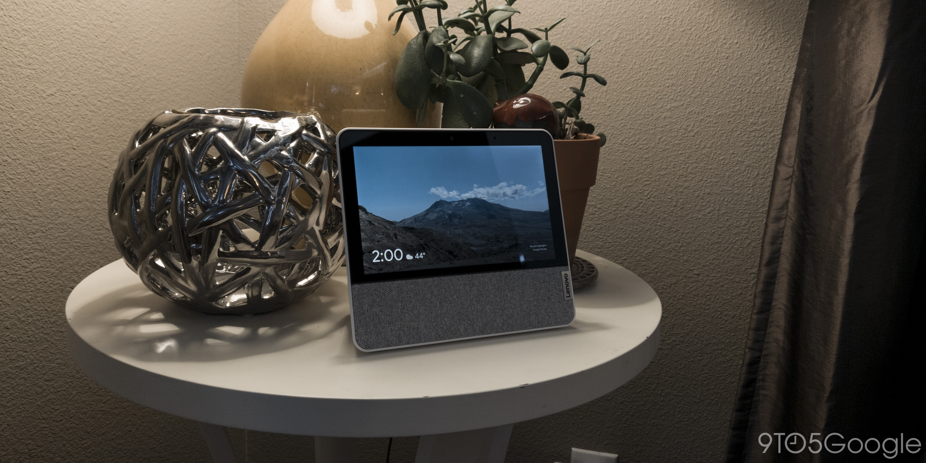 The Smart Display sitting on a table surrounded by small decor.