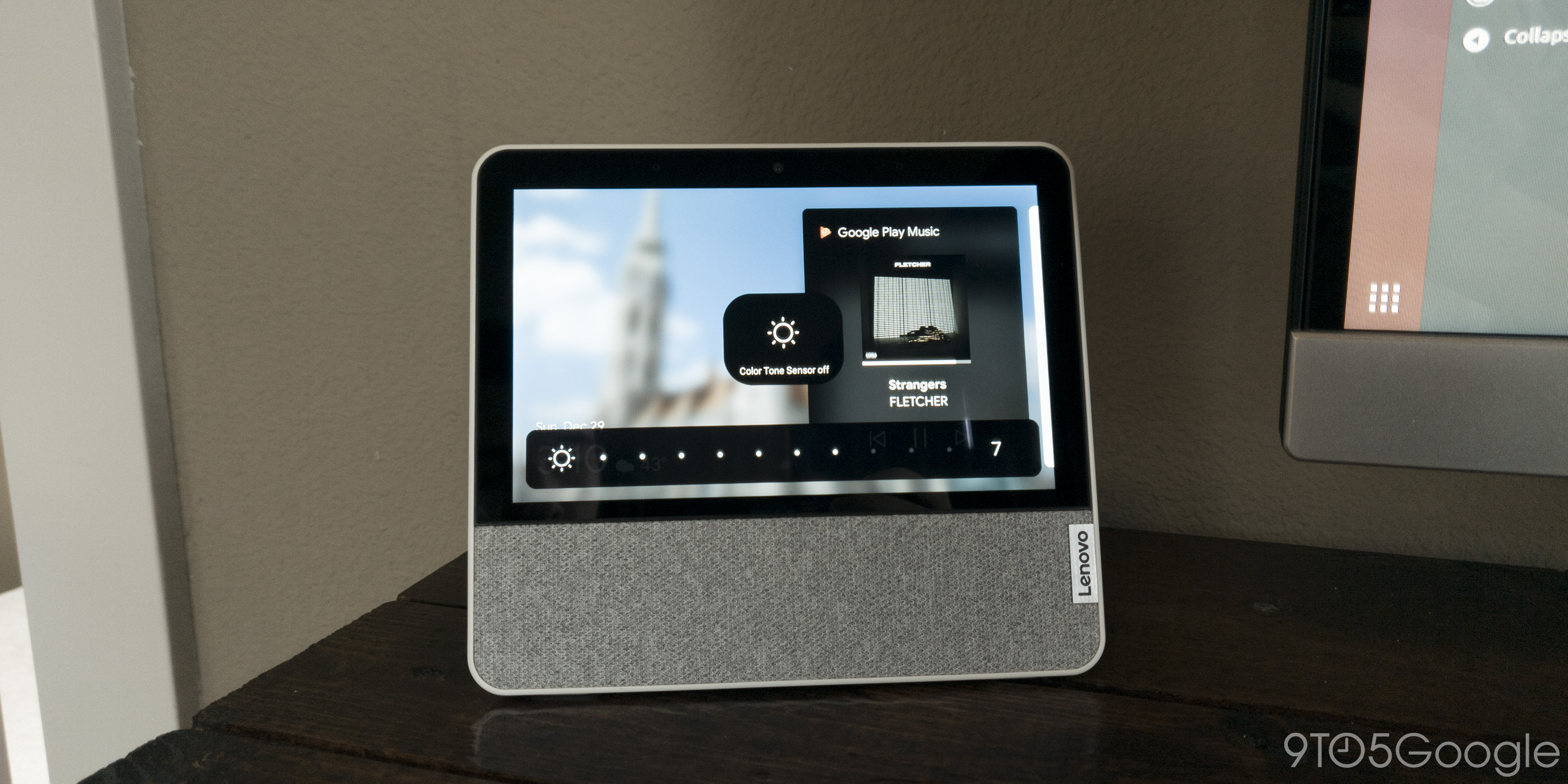 """The Lenovo Smart Display 7"""" sitting on a desk with the screen reading """"Color Tone Sensor off."""""""