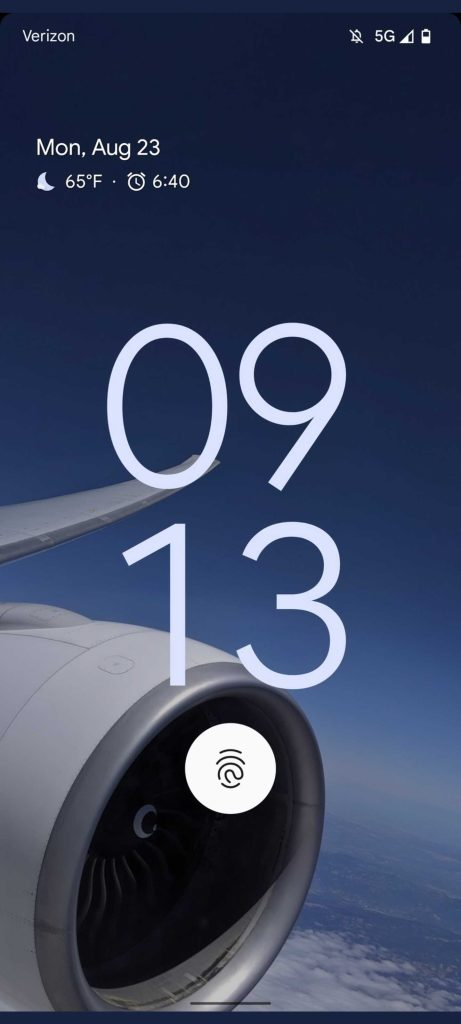 Screenshot of what might be the Pixel 6 Pro's lock screen, using an airplane's engine as its background